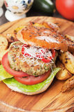 Vegan burger. With tomato and lettuce, healthy vegetarian version of classic american fast food Royalty Free Stock Photo