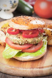 Vegan burger. With tomato and lettuce, healthy vegetarian version of classic american fast food Stock Images