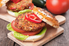 Vegan burger. With tomato and lettuce, healthy vegetarian version of classic american fast food Royalty Free Stock Photos