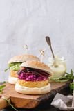 Vegan burgers with avocado, beetroot and sauce Royalty Free Stock Images