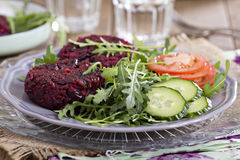 Vegan burgers with beetroot and beans Stock Photos