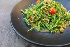 Vegan carpaccio with quinoa rucola salad. Yellow beetroot carpaccio with quinoa, rucola, green bean salad and pumpkin seeds Stock Photography