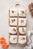 Vegan carrot cake with coconut cream and pecan, plant based diet. Vegan carrot cake with coconut cream and pecans on white board. Clean eating, healthy food royalty free stock photos