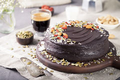 Vegan chocolate beet cake with avocado frosting, decorated nuts, seeds Stock Photos