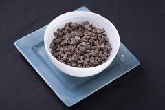 Vegan Chocolate Chips in White on Aqua Royalty Free Stock Photos