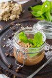 Vegan chocolate mousse with halvah and fresh mint in a jar stock images