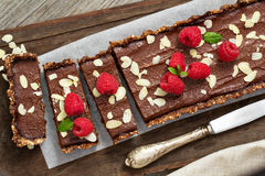 Vegan chocolate tart with almonds royalty free stock photo