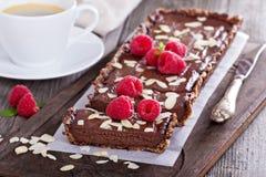 Vegan chocolate tart with almonds Royalty Free Stock Photo