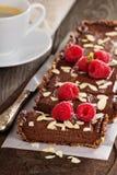 Vegan chocolate tart with almonds Royalty Free Stock Photos