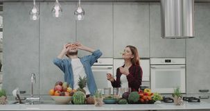 Vegan couple in the morning eating health breakfast , happy spending a good time in the kitchen with amazing big kitchen stock video
