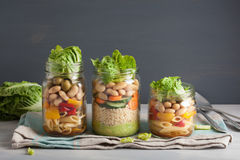 Vegan couscous and pasta salad in mason jars with vegetables bea Stock Photography