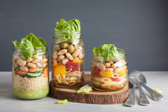 Vegan couscous and pasta salad in mason jars with vegetables bea Royalty Free Stock Photo