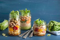 Vegan couscous and pasta salad in mason jars with vegetables bea Royalty Free Stock Image