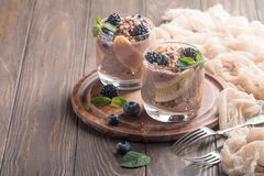 Chocolate chia pudding with banana. Vegan dessert, chocolate chia pudding with banana, berries and mint Royalty Free Stock Image