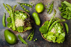 Vegan, detox green Buddha bowl recipe with quinoa, cucumber, broccoli, asparagus and sweet peas. Royalty Free Stock Photos