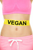 Vegan diet concept - word written on woman stomach Royalty Free Stock Photo