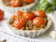 Tarts with lentils and cherry tomatoes stock photos