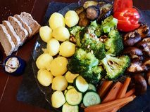 A vegan dinner with a plate of Vegetables. royalty free stock photo