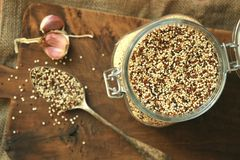 Vegan dish : quinoa seeds still life with an old spoon Stock Photo