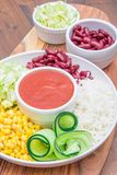 Vegan dish with rice,red beans , corn and cucumber. A vegan dish with rice,red beans , corn and cucumber stock photo