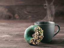 Vegan donuts topped spirulina glaze, copy space. Vegan doughnuts with chia seeds topped with healthy spirulina glaze with pistachio. Blue green spirulina donuts stock photos