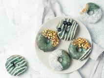 Vegan donuts topped spirulina glaze stock photo