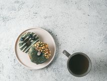 Vegan donuts topped spirulina glaze and tea royalty free stock images