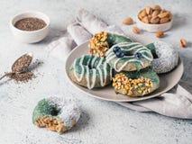 Vegan donuts topped spirulina glaze stock photography