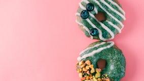 Donut topped spirulina glaze on pink royalty free stock photos