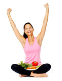 Vegan eating. Portrait of a cheerful woman celebrating healthy vegetables and vegan lifestyle Royalty Free Stock Photo