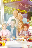 Vegan family with grandparents at lunch Royalty Free Stock Photos