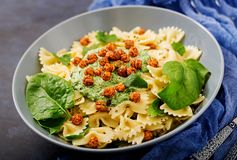 Vegan Farfalle Pasta With Spinach Sauce With Fried Chickpeas. Royalty Free Stock Image