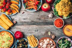 Free Vegan Food And Dishes. Baked Pumpkin, Salad, Corn, Nuts, Vegetables, Olives, Fruits On Wooden Background. Healthy, Clean Eating Stock Photo - 176777550