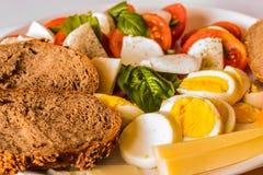 Vegan food. Crative vegetarian food. Bazil tomato and cheese mozzarela. Detail of food Stock Images