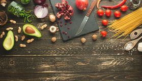 Vegan food, detox, avocado, fruit, green beans, broccoli, nuts and mushrooms. Diet and healthy food, vitamins and sports. Flat-lay. Clean and healthy food on a royalty free stock photo