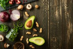 Vegan food, detox, avocado, fruit, green beans, broccoli, nuts and mushrooms. Diet and healthy food, vitamins and sports. Flat-lay. Clean and healthy food on a stock images