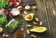 Vegan food, detox, avocado, fruit, green beans, broccoli, nuts and mushrooms. Diet and healthy food, vitamins and sports. Flat-lay. Clean and healthy food on a royalty free stock photography