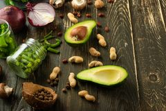 Vegan food, detox, avocado, fruit, green beans, broccoli, nuts and mushrooms. Diet and healthy food, vitamins and sports. Flat-lay. Clean and healthy food on a stock photography