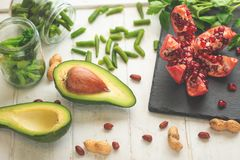Vegan food, detox, avocado, fruit, green beans, broccoli, nuts and mushrooms. Diet and healthy food, vitamins and sports. Flat-lay. Dieting breakfast food stock photography