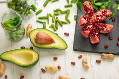 Vegan food, detox, avocado, fruit, green beans, broccoli, nuts and mushrooms. Diet and healthy food, vitamins and sports. Flat-lay. Dieting breakfast food royalty free stock photography