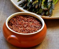 Vegan food: red rice and asparagus  Stock Photos