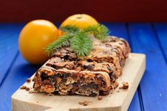 Vegan fruit cake with oranges and glass jar decorated with fir t Royalty Free Stock Images