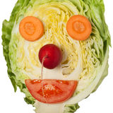 Vegan funny face. Assorted vegetables forming funny face Royalty Free Stock Images