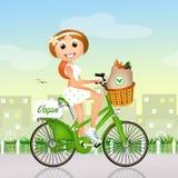 Vegan girl on bike Royalty Free Stock Images