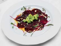 Vegan gluten-free avocado salsa, beetroot carpaccio, emulsion fr. Om xylitol and pine with cashew nuts stock photos