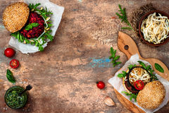 Vegan grilled eggplant, arugula, sprouts and pesto burger. Veggie beet and quinoa burger. Top view, overhead, flat lay. Copy space Stock Photos