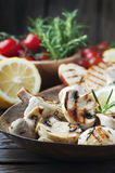 Vegan grilled mushroom with lemon and rosemary Royalty Free Stock Photos