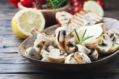 Vegan grilled mushroom with lemon and rosemary Stock Photography