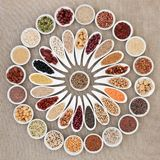 Vegan Health Food. Vegan high protein dried health food collection with nuts, seeds, legumes, pasta, grains and cereals. Foods high in fiber, antioxidants stock photography
