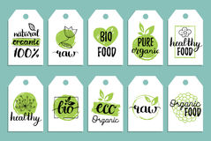Vegan, healthy food cards or tags set for cafe,restaurant, packaging etc. Vector eco, organic signs with hand lettering. Vegan, healthy food cards or tags set Stock Image